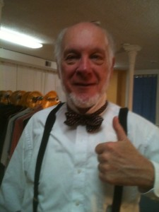 Charlie (Ray Mahoney) ties his bow tie